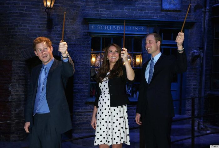 "Prince Harry, Kate Middleton and Prince William raise their wands on the ""Harry Potter"" set during the Inauguration Of Warner Bros. Studios Leavesden on April 26, 2013."