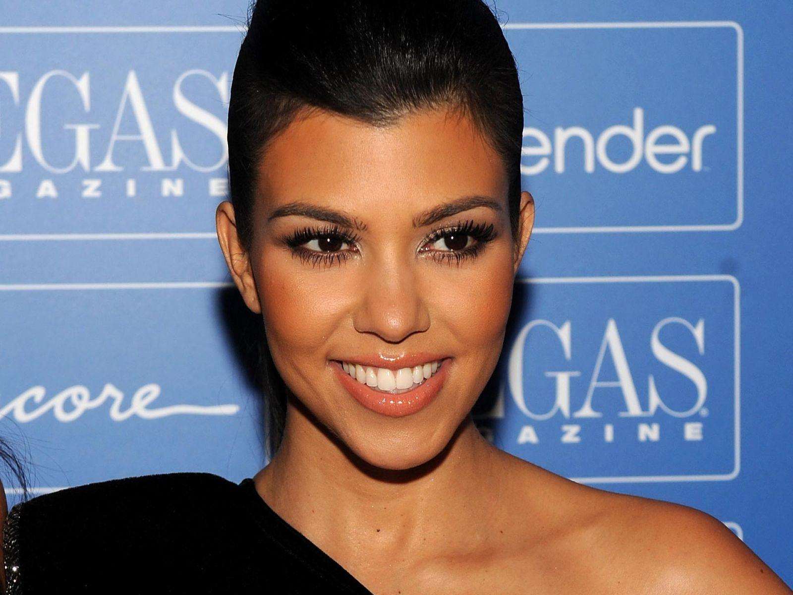 Kourtney Kardashian Follows in Kims Footsteps With Her