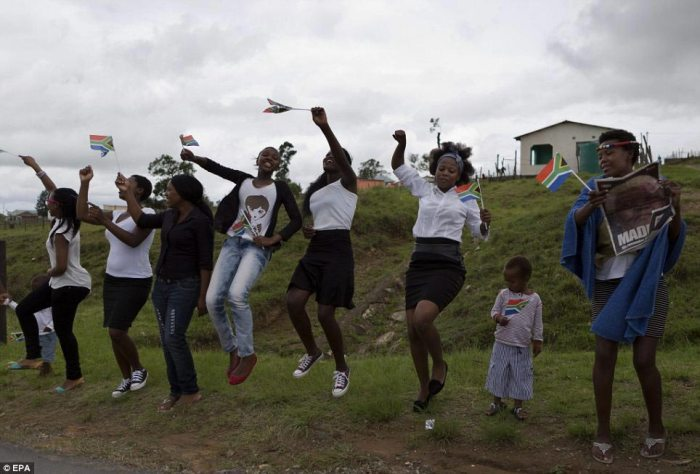 Africa: Young women dance by the roadside in the small village of Queque, near Qunu, as they wait to watch the funeral procession to sweep by