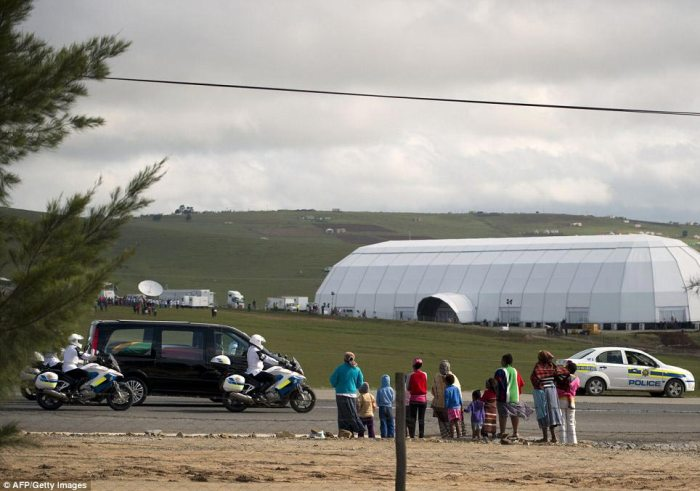 Journey's end: The hearse carrying the coffin of former South African president Nelson Mandela passes by the tent dome set up in Qunu for his funeral