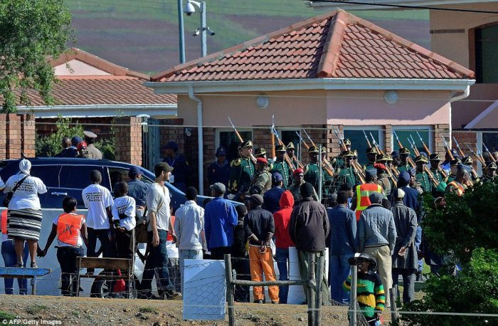 A military guard of honour stands to attention at the Mandela family's homestead in Qunu. Mandela, the revered icon of the anti-apartheid struggle in South Africa and one of the towering political figures of the 20th century, died in Johannesburg on December 5 at age 95