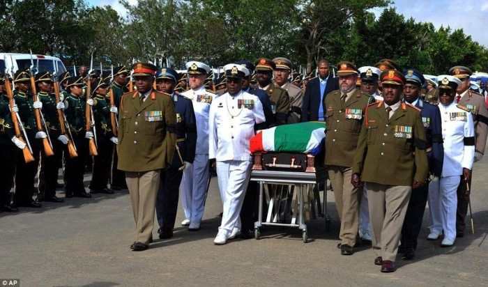 Home at last: Military officers and Nelson Mandela's grandson Mandla Mandela, rear, accompany the casket of the former South African President as it arrives in Qunu