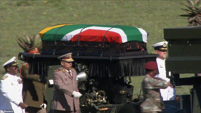 Final goodbye: The flag-draped casket of South Africa's first black president arrives in Mandela's village