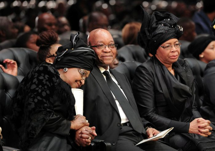QUNU, SOUTH AFRICA - DECEMBER 15 (SOUTH AFRICA AND FRANCE OUT):  Winnie Madikizela-Mandela, President Jacob Zuma and Graca Machel during Madiba's State Funeral on December 15, 2013 in Qunu, South Africa. Nelson Mandela passed away on the evening of December 5, 2013 at his home. He is laid to rest at his homestead in Qunu during a State Funeral.  (Photo by Felix Dlangamandla/Foto24/Gallo Images/Getty Images)