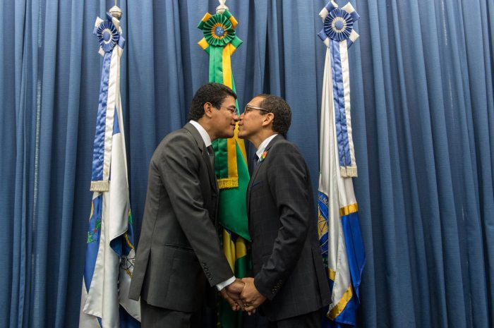 Claudio Nascimento (R), an LGBT activist of Rio de Janeiro State, poses with his partner Joao Silva after the wedding ceremony at the Court of Justice of the State of Rio de Janeiro in Rio de Janeiro, Brazil, on December 8, 2013. 130 gay couples are getting married in the first massive wedding ceremony since the first gay marriage in Rio de Janeiro in 2011. AFP PHOTO / YASUYOSHI CHIBA (Photo credit should read YASUYOSHI CHIBA/AFP/Getty Images)