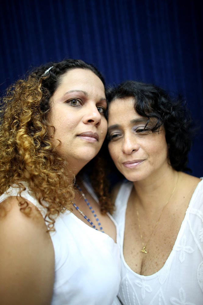 Couple Roberta Felitte and Karina Soares, together five years, pose before marrying at what was billed as the world's largest communal gay wedding on December 8, 2013 in Rio de Janeiro, Brazil. 130 couples were married at the event which was held at the Court of Justice in downtown Rio. In May, Brazil became the third country in Latin America to effectively approve same-sex marriage via a court ruling, but a final law has yet to be passed. (Photo by Mario Tama/Getty Images)