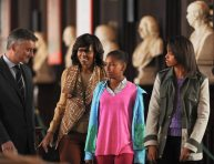 (L-R) US First Lady Michelle Obama accompanied by her two daughters, Sasha and Malia, tours the Old Library Building at Trinity College, Ireland's oldest university, accompanied by the director Patrick Prendergast (L) in Dublin, Ireland, on June 17, 2013. The US First Lady visited Dublin in the Republic of Ireland as her husband US President Barack Obama attended the G8 Summit in Lough Erne in Northern Ireland. AFP PHOTO / ARTUR WIDAKARTUR WIDAK/AFP/Getty Images