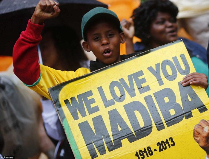 Father of the country: Many, like this little boy, refer to the former president using his tribal name, Madiba