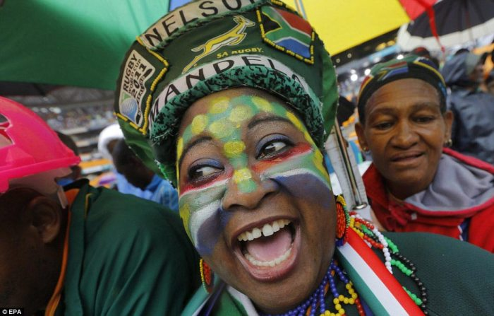 Colourful: A woman dressed in the regalia of the South African national rugby team arriving at the stadium