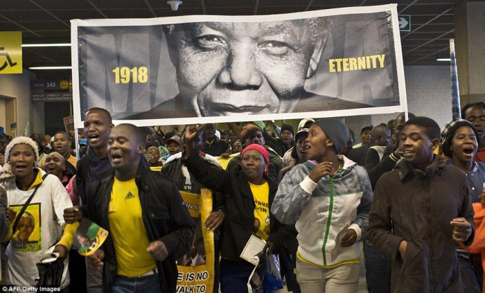Banner: Supporters carrying a large sign which paid tribute to Mandela's lasting legacy in South Africa and the rest of the world
