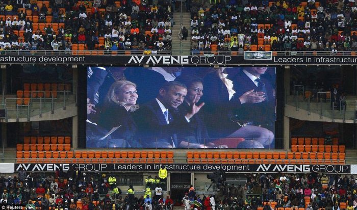 Cheers: When America's first couple flashed up on screen the crowd roared their approval of the U.S.'s first black President