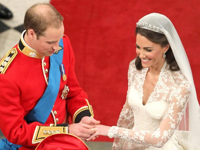 LONDON, ENGLAND - APRIL 29: Prince William exchanges rings with his bride Catherine Middleton in front of the Archbishop of Canterbury, Rowan Williams inside Westminster Abbey on April 29, 2011 in London, England. The marriage of Prince William, the second in line to the British throne, to Catherine Middleton is being held in London today. The marriage of the second in line to the British throne is to be led by the Archbishop of Canterbury and will be attended by 1900 guests, including foreign Royal family members and heads of state. Thousands of well-wishers from around the world have also flocked to London to witness the spectacle and pageantry of the Royal Wedding. (Photo Credit: Andrew Milligan - WPA Pool/Getty Images)