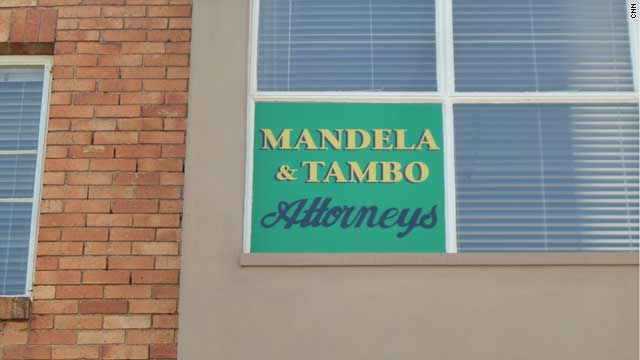 """In the early 1950s, Mandela opened South Africa's first black law firm with political activist Oliver Tambo. Mandela called the firm a """"first choice and last resort"""" for its clients, looking to challenge injustices of the apartheid system. The offices of the firm closed in 1960 after being burned down."""