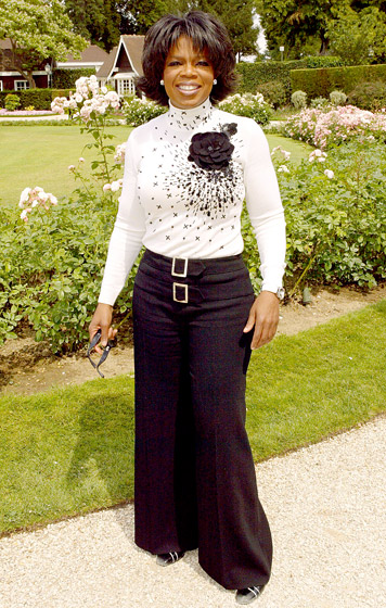 July 2004: Winfrey in Paris at the Christian Dior Haute Couture fashion show (Photo Credit: Tony Barson/WireImage.com)