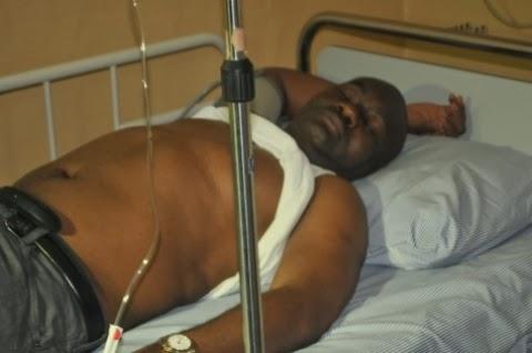 Senator Abe pictured on a hospital bed (Photo Credit: Linda Ikeji)