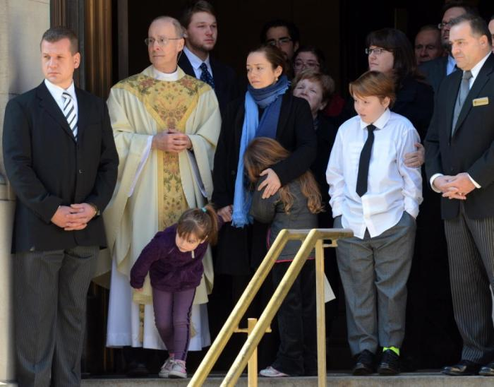 Philip Seymour Hoffman's longtime girlfriend Mimi O'Donnell and their 3 children just exited the Manhattan church where the actor's funeral just ended ... and it was emotional. Mimi -- flanked by 10-year-old son Cooper, 7-year-old daughter Tallulah and 5-year-old daughter Willa -- exited the Church of St. Ignatius Loyola (Photo Credit: Debbie Egan-Chin/New York Daily News)