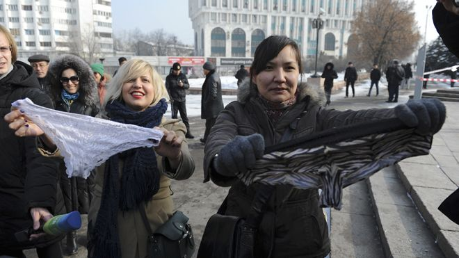"On Sunday, 30 women protesters in Kazakhstan were arrested and thrown into police vans while wearing lace underwear on their heads and shouting ""Freedom to panties!"" (Photo: Reuters)"