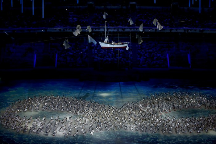 Performers take part in the Closing Ceremony of the Sochi Winter Olympics at the Fisht Olympic Stadium on February 23, 2014. AFP PHOTO / ADRIAN DENNIS (Photo credit should read ADRIAN DENNIS/AFP/Getty Images)