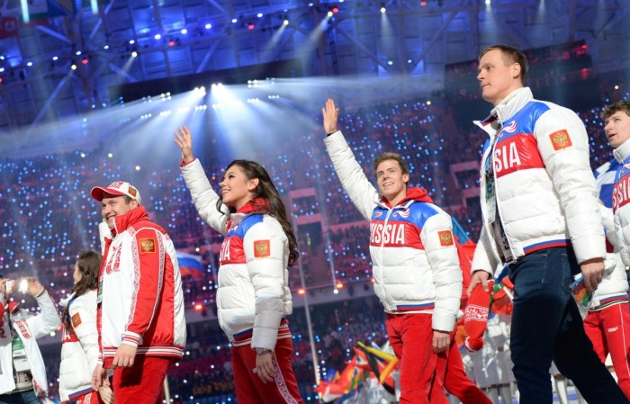 Russian figure skaters Nikita Katsalapov (2ndR) and Elena Ilinykh (C) parade during the Closing Ceremony of the Sochi Winter Olympics at the Fisht Olympic Stadium on February 23, 2014. AFP PHOTO / DAMIEN MEYER (Photo credit should read DAMIEN MEYER/AFP/Getty Images)