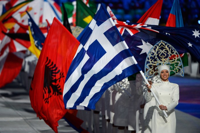SOCHI, RUSSIA - FEBRUARY 23: The competing nations flags enter the 2014 Sochi Winter Olympics Closing Ceremony at Fisht Olympic Stadium on February 23, 2014 in Sochi, Russia. (Photo by Pascal Le Segretain/Getty Images)