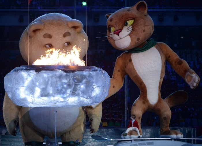 The polar bear and leopard mascots stand in front of a small cauldron as they prepare to extinguish it during the Closing Ceremony of the Sochi Winter Olympics at the Fisht Olympic Stadium on February 23, 2014. AFP PHOTO / PETER PARKS (Photo credit should read PETER PARKS/AFP/Getty Images)