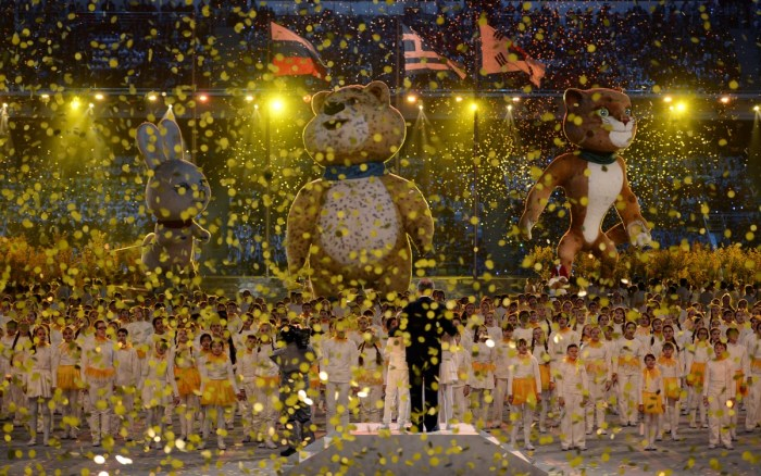 Performers stand near the Sochi Olympics winter games official mascots during the Closing Ceremony of the Sochi Winter Olympics at the Fisht Olympic Stadium on February 23, 2014. AFP PHOTO / PETER PARKS (Photo credit should read PETER PARKS/AFP/Getty Images)