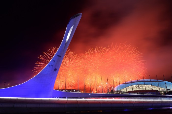 Fireworks explode behind the Olympic flame claudron after it was extinguished at the end of the Closing Ceremony of the Sochi Winter Olympics outside the Fisht Olympic Stadium on February 23, 2014. AFP PHOTO / YURI KADOBNOV (Photo credit should read YURI KADOBNOV/AFP/Getty Images)