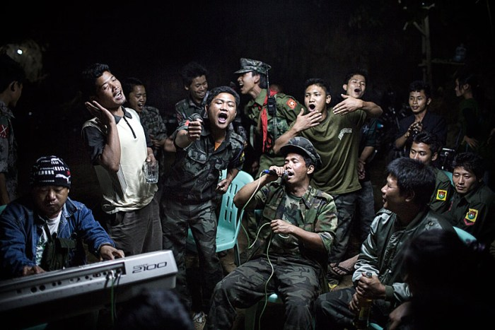 1st Prize Daily Life SingleJulius Schrank, Germany, De Volkskrant15 March 2013, BurmaKachin Independence Army fighters drinking and celebrating at a funeral of one of their commanders who died the day before. The city is under siege by the Burmese army.Picture: JULIUS SCHRANK/DE VOLKSKRANT