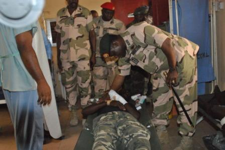 CHIEF OF ARMY STAFF  LT GEN KENNETH MINIMA ATTENDING TO ONE OF THE JTF WOUNDED SOLDIER MAIDUGURI BORNO STATE