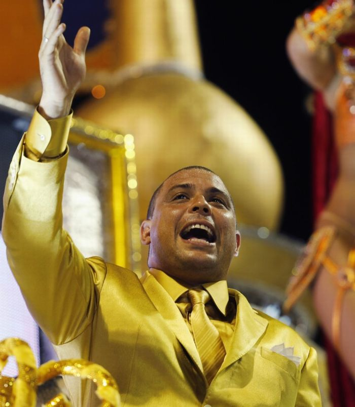 Dressed in a gold suit, Ronaldo stood on the huge float with his mother and father (Photo Credit: Daily Mirror)