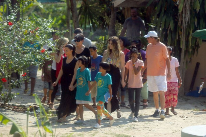 Kim and her family were see walking through a local village (Photo Credit: Slash/Daily Mirror)