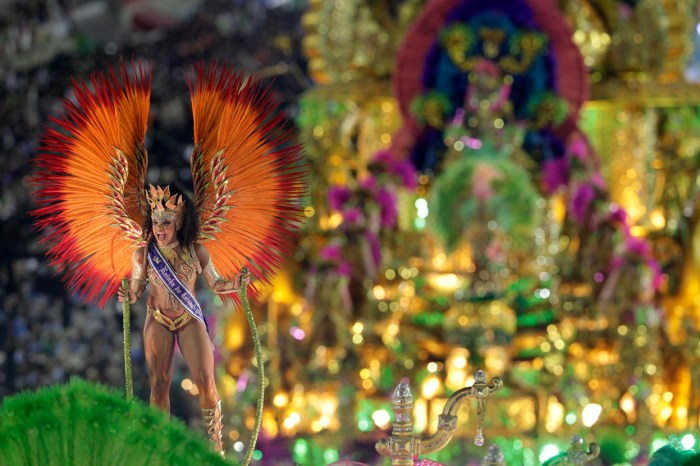 A performer from the Mangueira samba school, during carnival celebrations in Rio de Janeiro, on February 11, 2013. (AP Photo/Hassan Ammar)