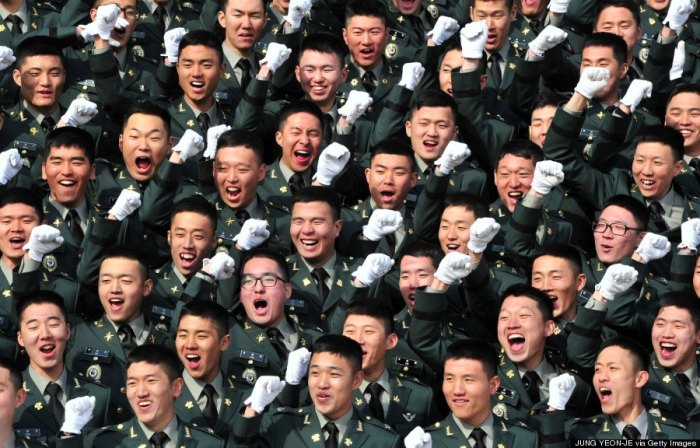 South Korean new military officers cheer during the joint commission ceremony of 5,860 new officers of the army, navy, air force and marines at the military headquarters in Gyeryong, south of Seoul, on March 6, 2014. South Korean President Park Geun-Hye urged North Korea to give up its nuclear program, saying denuclearization will pave the way for greater economic cooperation and ultimately unification between the two divided states.        (Photo Credit: JUNG YEON-JE/AFP/Getty Images)