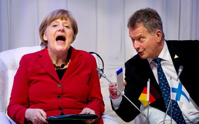 We have no idea what Finnish President Sauki Niinisto has on his note pad, but it has clearly tickled Ms Merkel (Photo Credit: BART MAAT)