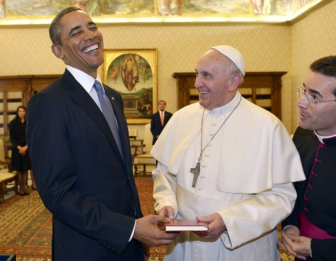 Pope Francis and President Barack Obama smile as they exchange gifts at the Vatican (Photo Credit: GABRIEL BOUYS/AP)