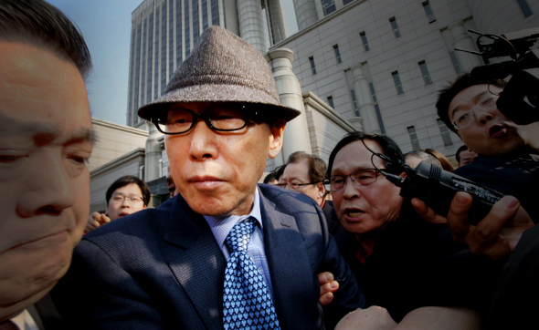 David Yonggi Cho pictured leaving the court