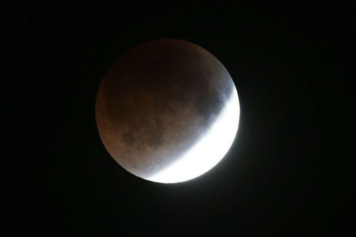 The moon is seen as it heads into a total lunar eclipse (Photo Credit: Getty Images)