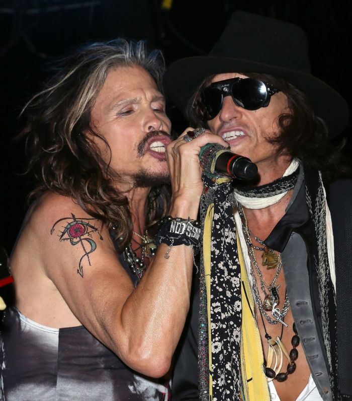 Recording artists Steven Tyler (L) and Joe Perry of Aerosmith perform on stage in West Hollywood, California