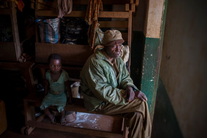 Grimari. Aman and his daughter took refuge in a classroom of the catholic mission of Grimari. 4800 displaced christians took refugee there to flee the fighting between ex Seleka and Antibalakas,  Grimari is being attacked by Antibalakas for 2 days as it is the gate to the Ouaka region that is still controlled by ex Seleka fighters whose general Ali Mahamat Darrassa is relatively appreciated by both muslims and christians for having fought and expelled others Seleka who were installing terror among the city communities. Sangaris troops trust him, thinking he is the only way to keep Ouaka region out of violence between christians and muslims. (Photo Credit: William Daniels/Panos)