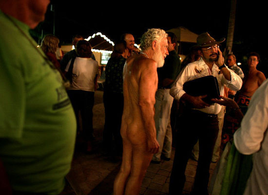 PHOTO: Nudists and politicians mill around together after a candidates debate for the open seats on the Loxahatchee Groves Town Council March 1, 2007 at the Sunsport Gardens Family Naturist Resort in Loxahatchee Groves, Florida. (Photo Credit: Joe Raedle/Getty Images)