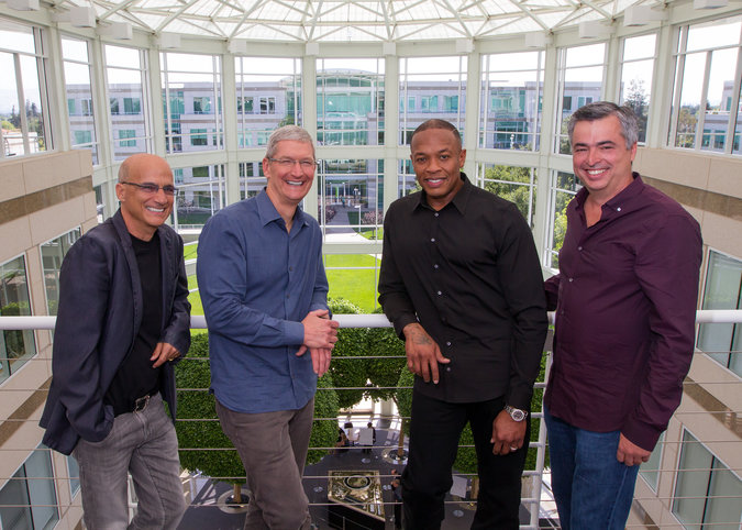 From left, Jimmy Iovine, a longtime music executive; Timothy D. Cook, Apple's chief; Dr. Dre, the rapper; and Eddy Cue, Apple's executive in charge of Internet services. As part of Apple, Mr. Iovine and Dr. Dre will work under Mr. Cue. (Photo Credit Paul Sakuma/Apple)