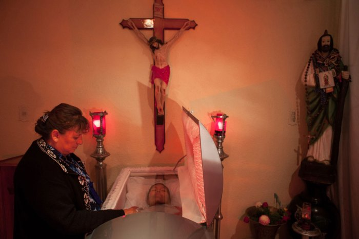 Mexico City, 2010, A sex worker, who prefers not to share her name, attends the funeral of another sex worker who died of cancer at age 64. (Photo Credit: Slate/Bénédicte Desrus)