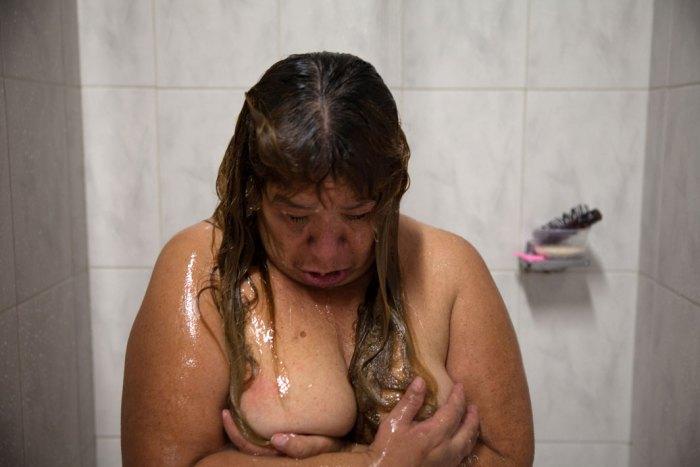 Mexico City, 2013,  Juana, a residet of Casa Xochiquetzal, takes a shower at the shelter. (Photo Credit: Slate/Bénédicte Desrus)