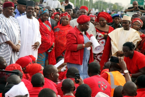 The #BringBackOurGirls protests in Abuja yesterday, May 22, 2014. Pictured with a microphone is former VP of the World Bank, Oby Ezekwesili and Minister of Information Labaran Makun (In black cap) and other government officials in the background (Photo Credit: Sahara Reporters)