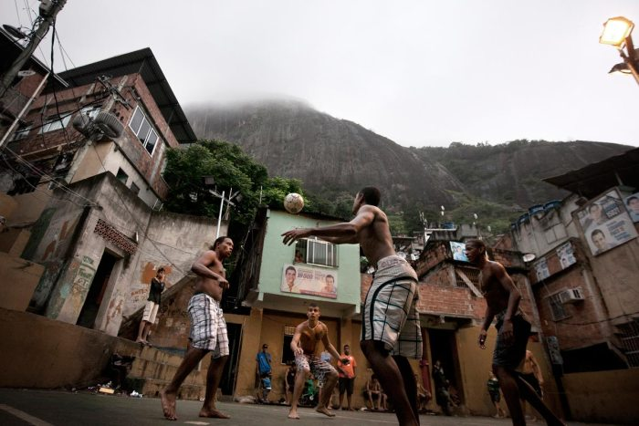 Several teenagers play soccer in Rocinha, the largest shantytown in Rio de Janeiro, Brazil. Nov. 26, 2012 (Photo Credit: Rafael Fabrés/Wires)