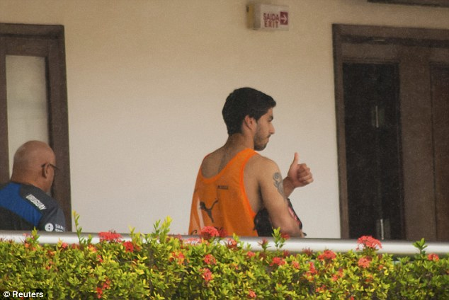 Gesture: Suarez gives a thumbs-up from a balcony of the Uruguay team hotel in Natal (Photo Credit: AP)