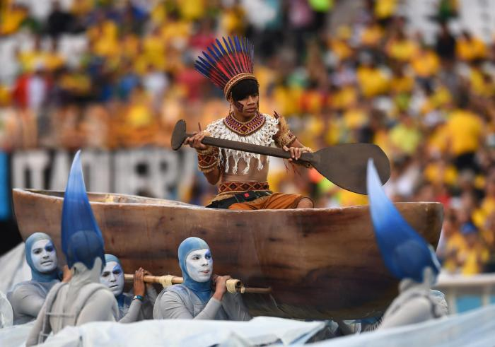 A performer is carried in a boat during the Opening Ceremony