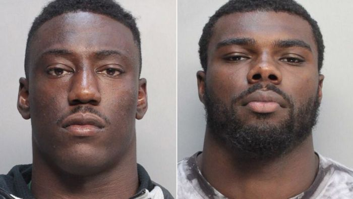 University of Miami football players JaWand Blue and Alexander Figueroa are shown in booking photos July 8, 2014.