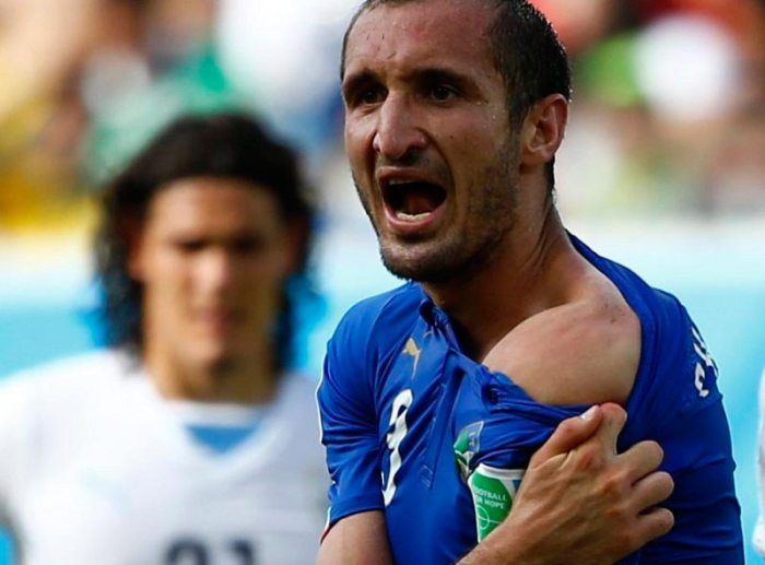 Italy's Giorigo Chiellini is bitten by a member of the Uruguay team. Source: TIME