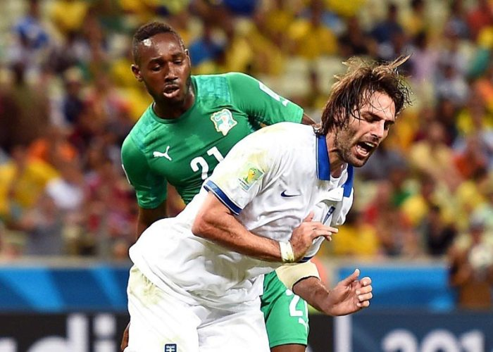 The Ivory Coast's Giovanni Sio fouls Greece's Giorgos Samaras, giving the team a free penalty kick. Source: USA Today Sports
